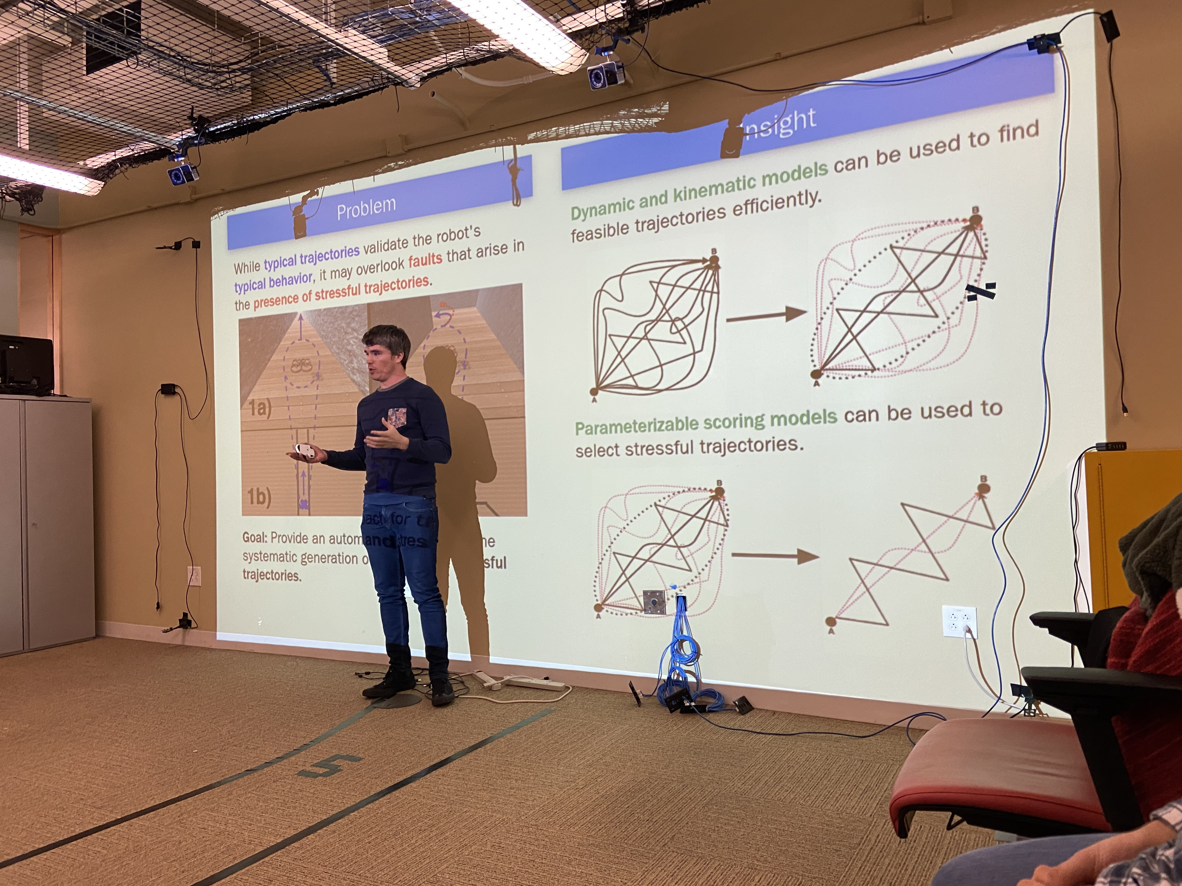 Carl giving a talk on his recently published work on creating stressful trajectories for robots.
