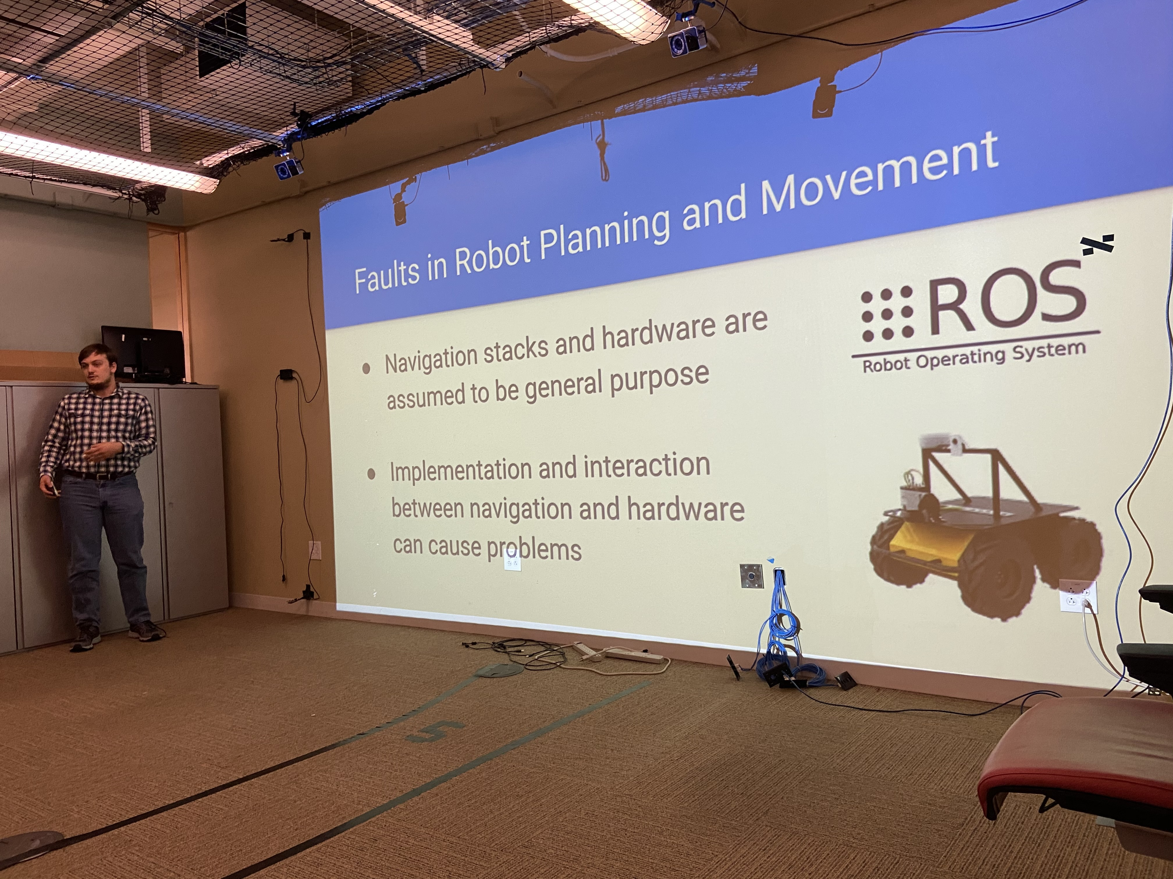 Trey talking about his current work on identifying and predicting faults in robots.
